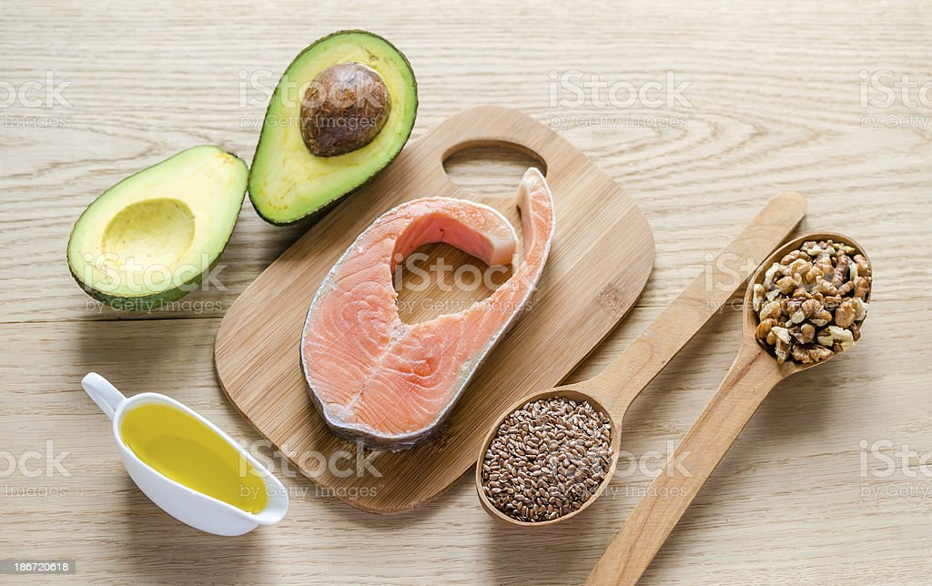 An assortment of foods with unsaturated fats stock photo