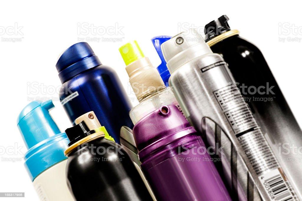 An assortment of hairspray bottles stock photo