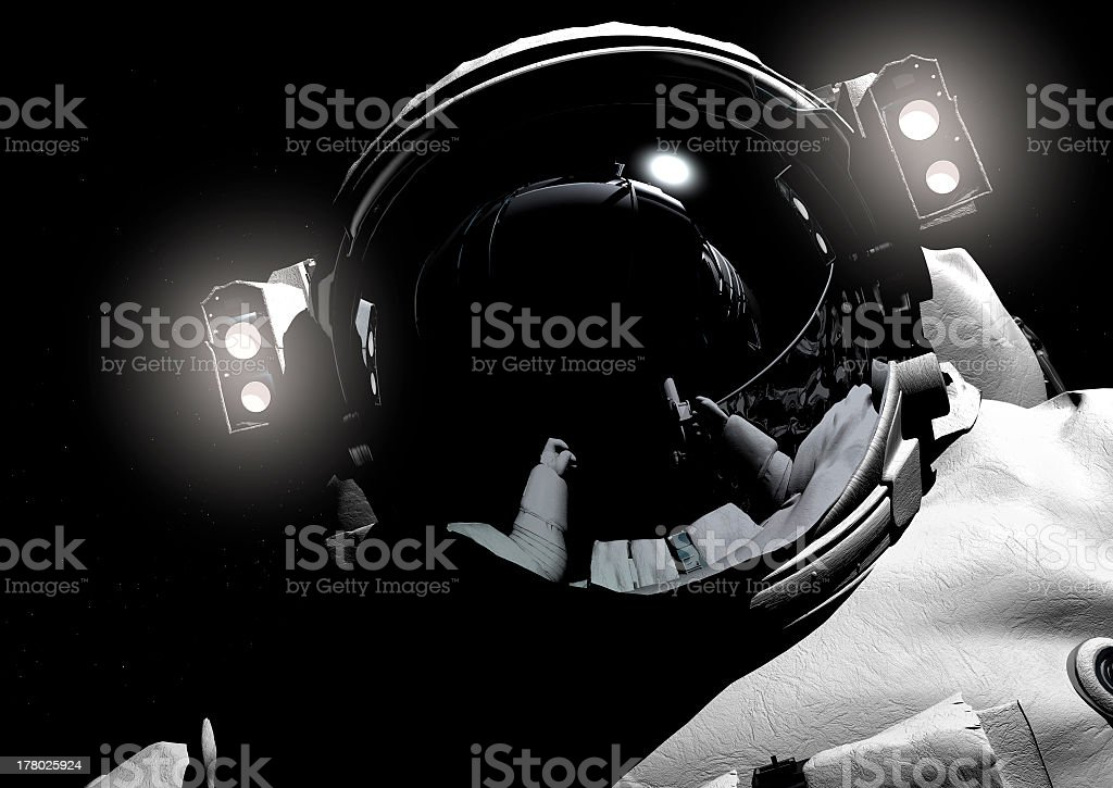 An astronaut with lights on the space helmet stock photo