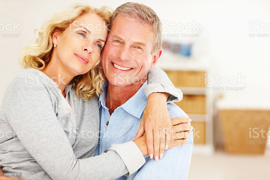An attractive couple embracing each other at home royalty-free stock photo