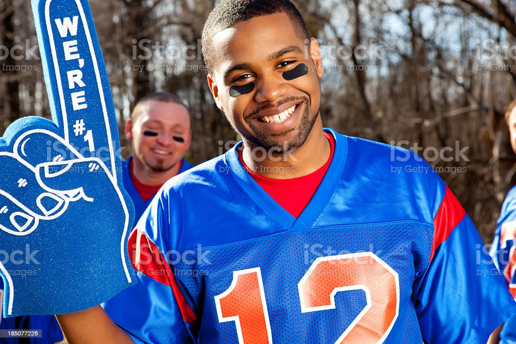 An attractive male football fan wearing a 12 jersey stock photo