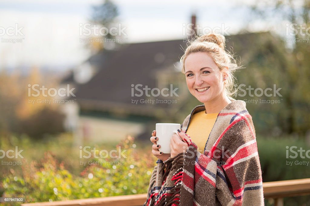 An attractive young adult female is standing outside stock photo