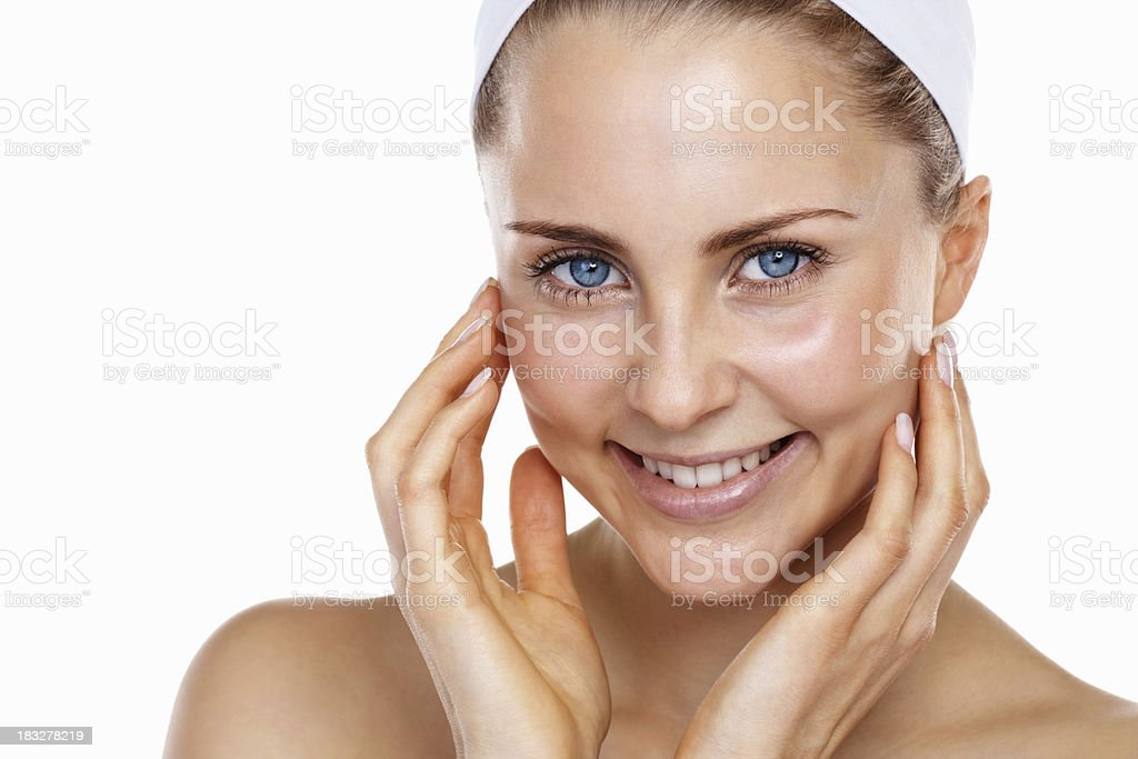An attractive young lady touching her face royalty-free stock photo