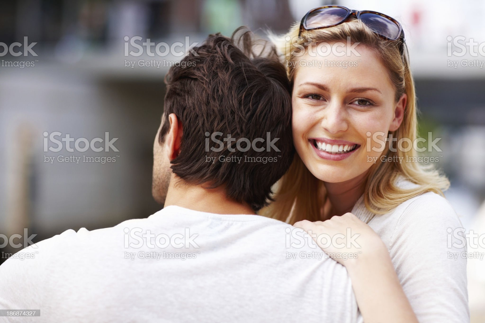 An attractive, young woman hugging her boyfriend royalty-free stock photo