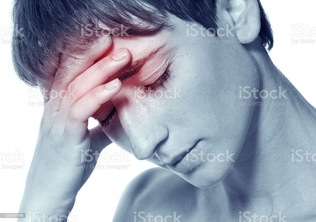 An attractive young woman with migraine pain stock photo