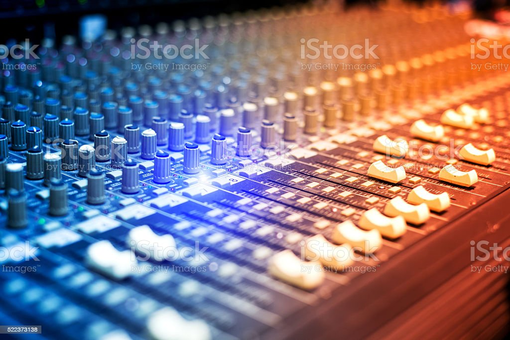 An Audio mixing table in soft light stock photo