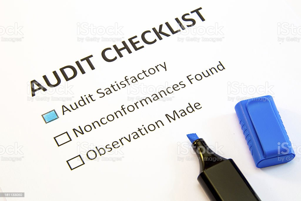 An audit checklist with the highest satisfactory checked stock photo