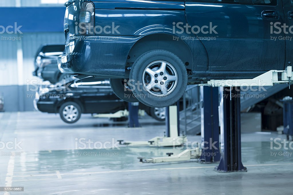 An auto repair shop full of cars to be fixed  stock photo