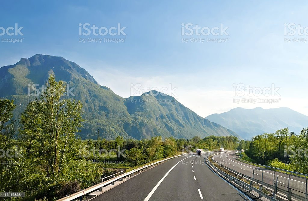 An autobahn with mountains and trees stock photo