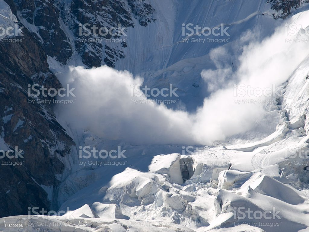 An avalanche in motion in the icy wind stock photo