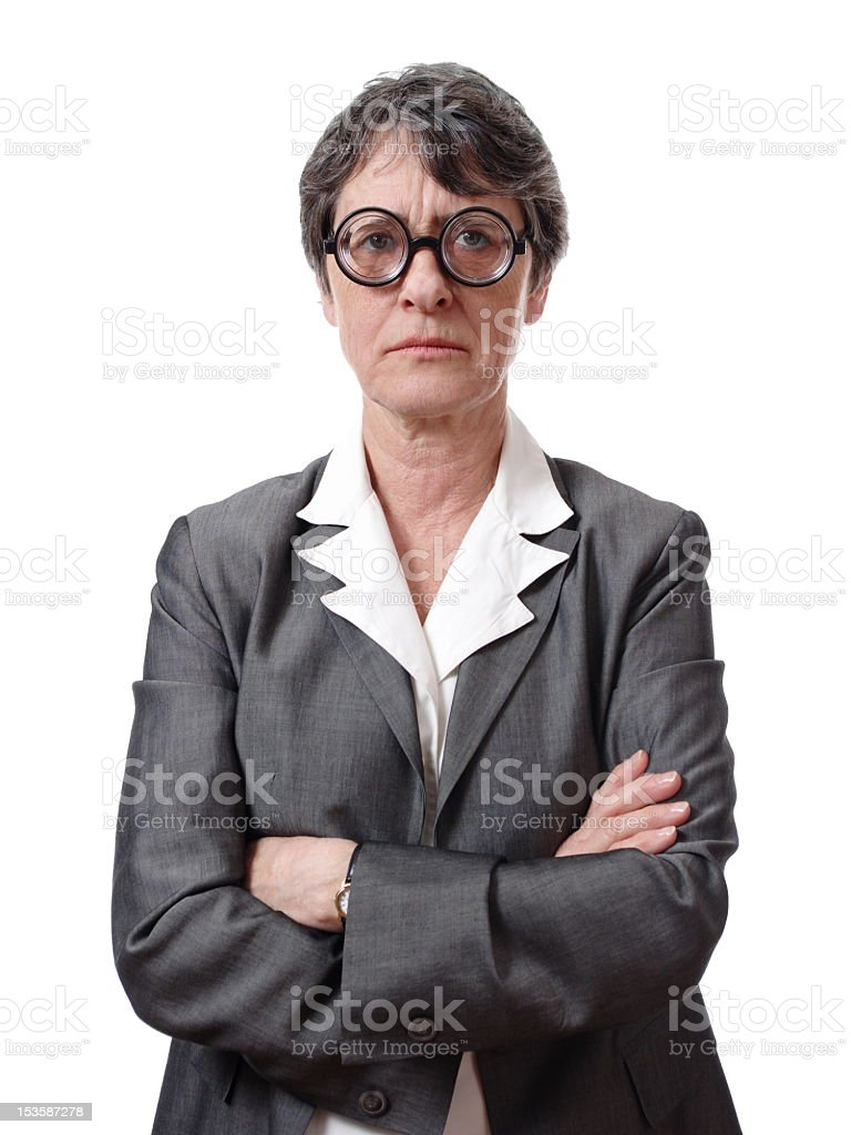 An businesswoman with round glasses looking angry royalty-free stock photo
