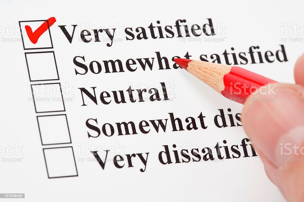 An checklist with a red check mark on Very Satisfied royalty-free stock photo