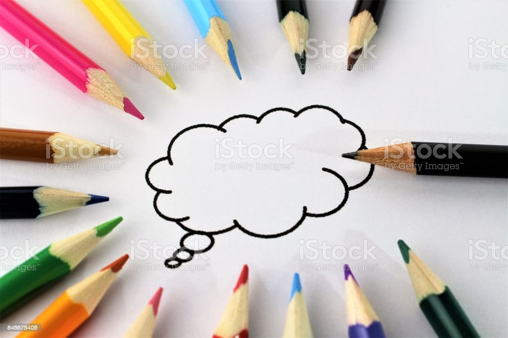 An concept image of a speech bubble with colorful pencils stock photo