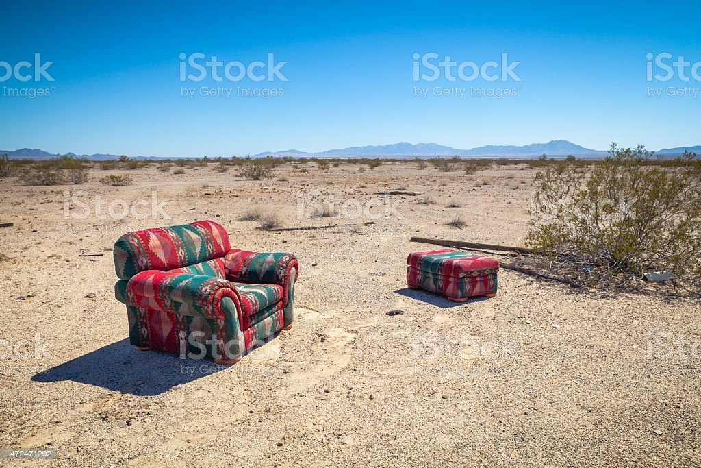 An Easy Chair And Ottoman Abanoned In The Desert royalty-free stock photo