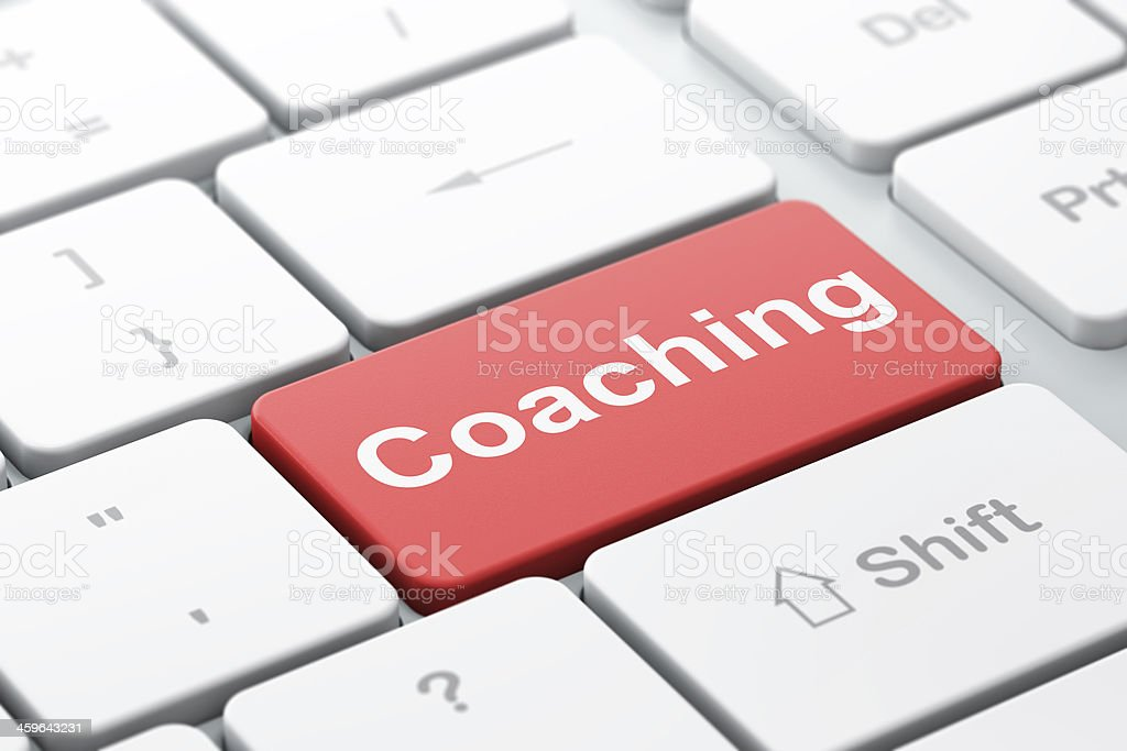 An edited keyboard with the key coaching in red stock photo