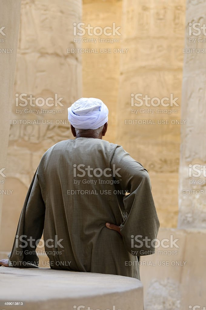 Egyptian caretaker at Great Hypostyle Hall in Luxor royalty-free stock photo