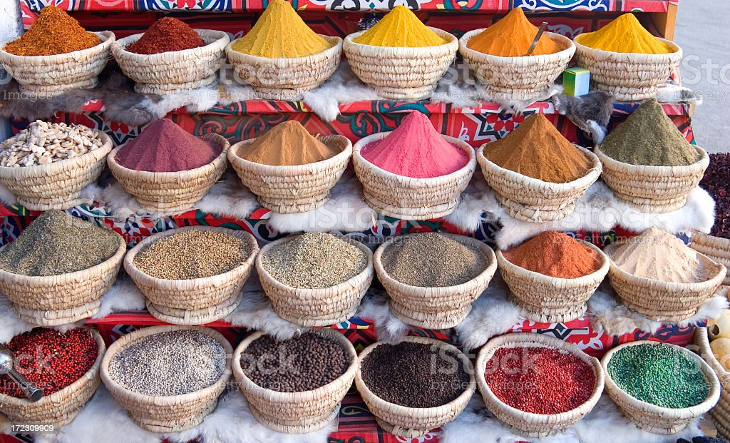 An Egyptian spice market with baskets full of spice stock photo