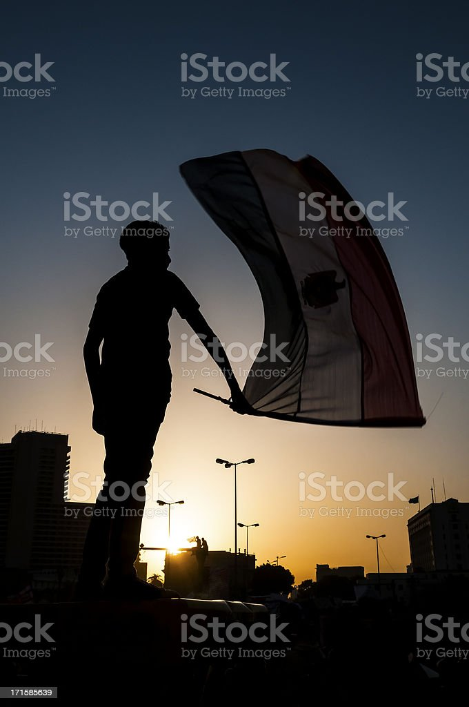Egyptian waving flag in Tahrir Square stock photo