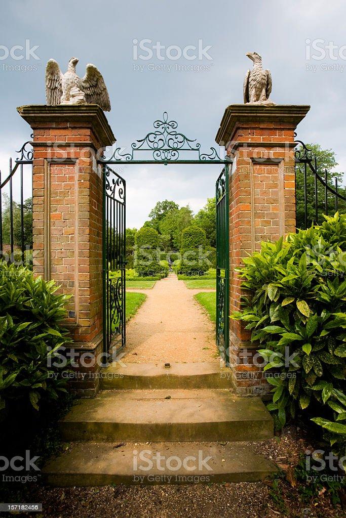 An elaborate gated entrance to an idyllic English garden royalty-free stock photo