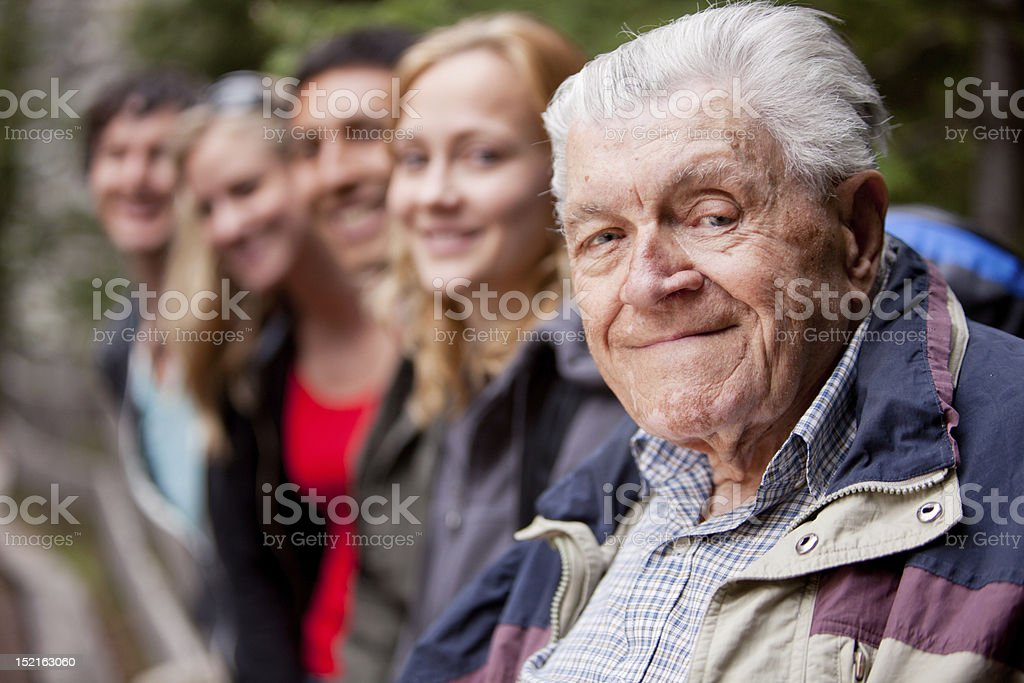 An elderly man looking into the camera stock photo
