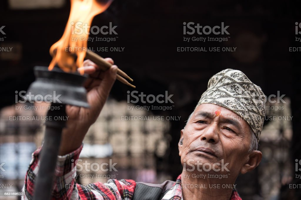 An elderly man participating in a ceremonial procession. stock photo
