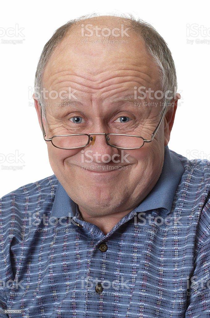 An elderly senior man looking happily towards the camera royalty-free stock photo