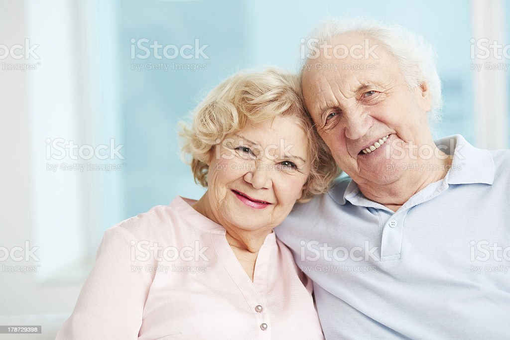 An elderly white couple smiling enjoying their retirement royalty-free stock photo