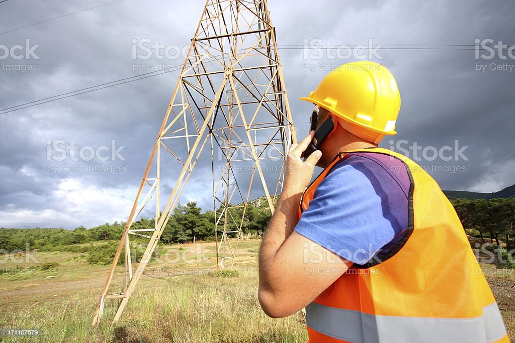 An electrician looking at a tower stock photo