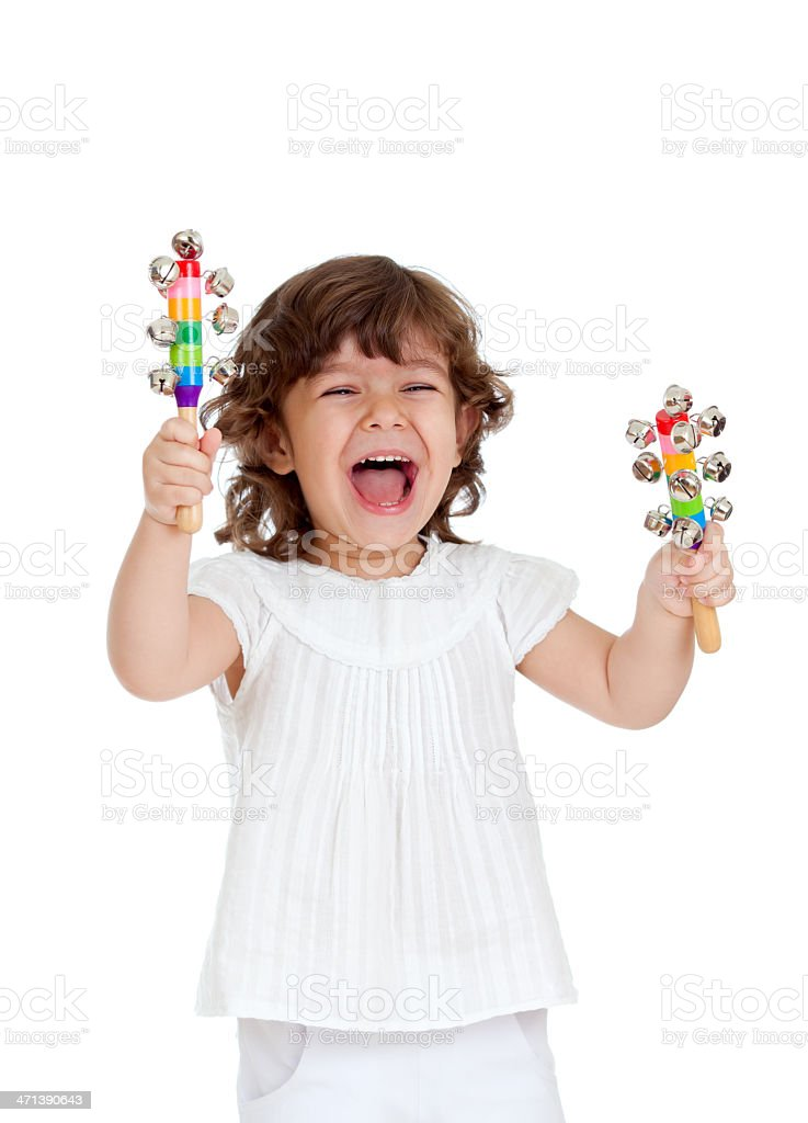 An emotional child playing with musical toys stock photo