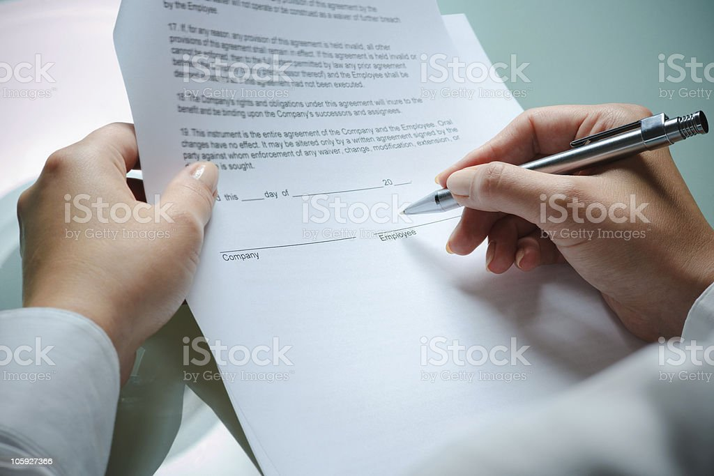An employment agreement between two parties  stock photo