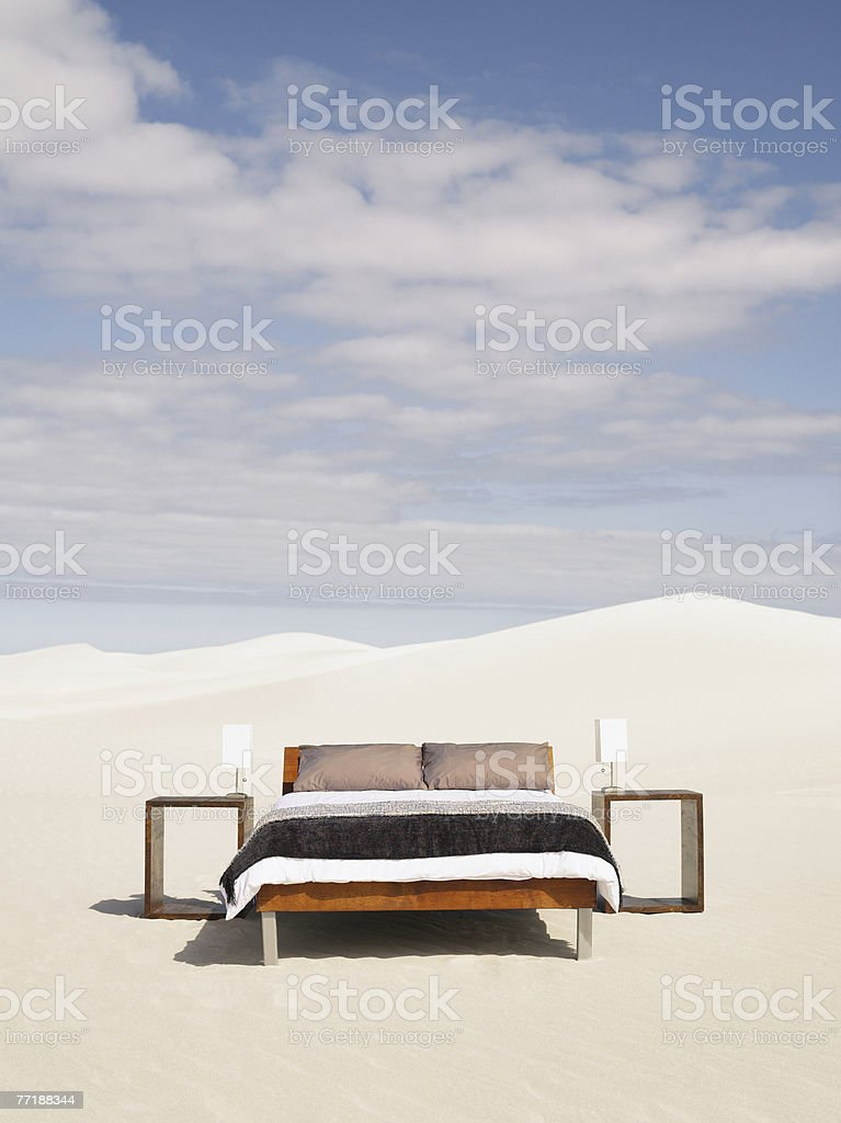 An empty bed in the middle of the desert stock photo