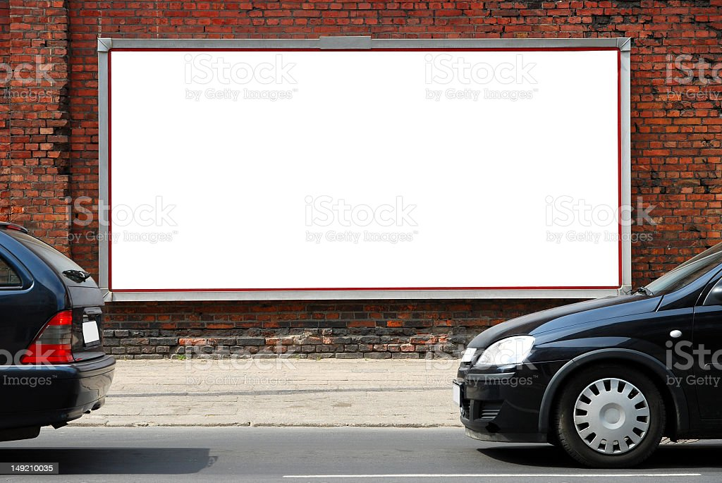 An empty billboard sign on a street wall stock photo