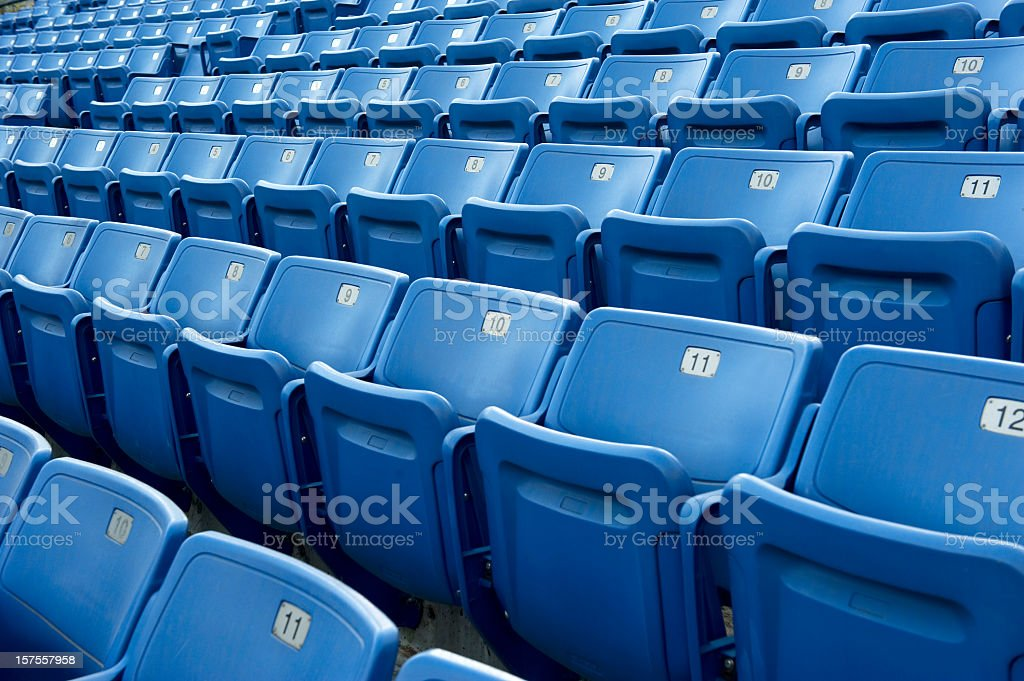 An empty blue arena seats with numbers stock photo