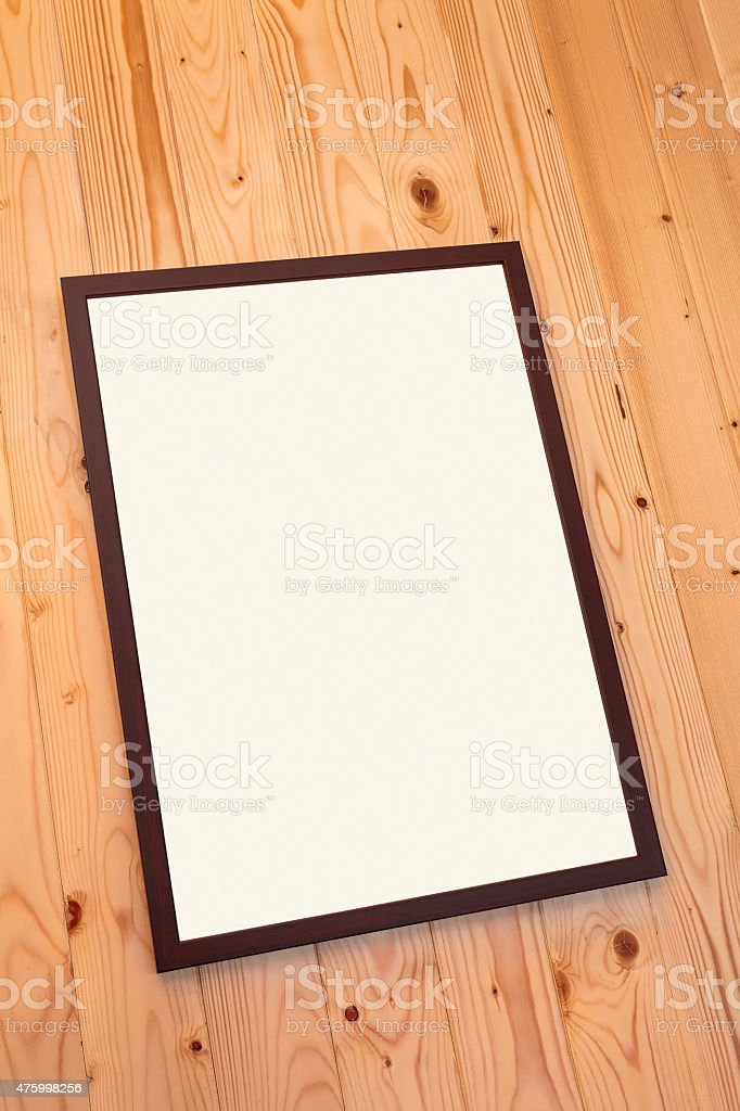 an empty frame on the woody wall stock photo