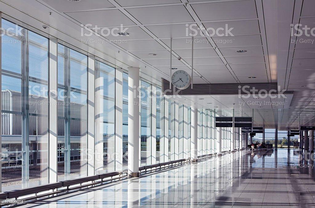 An empty hallway at an airport terminal stock photo