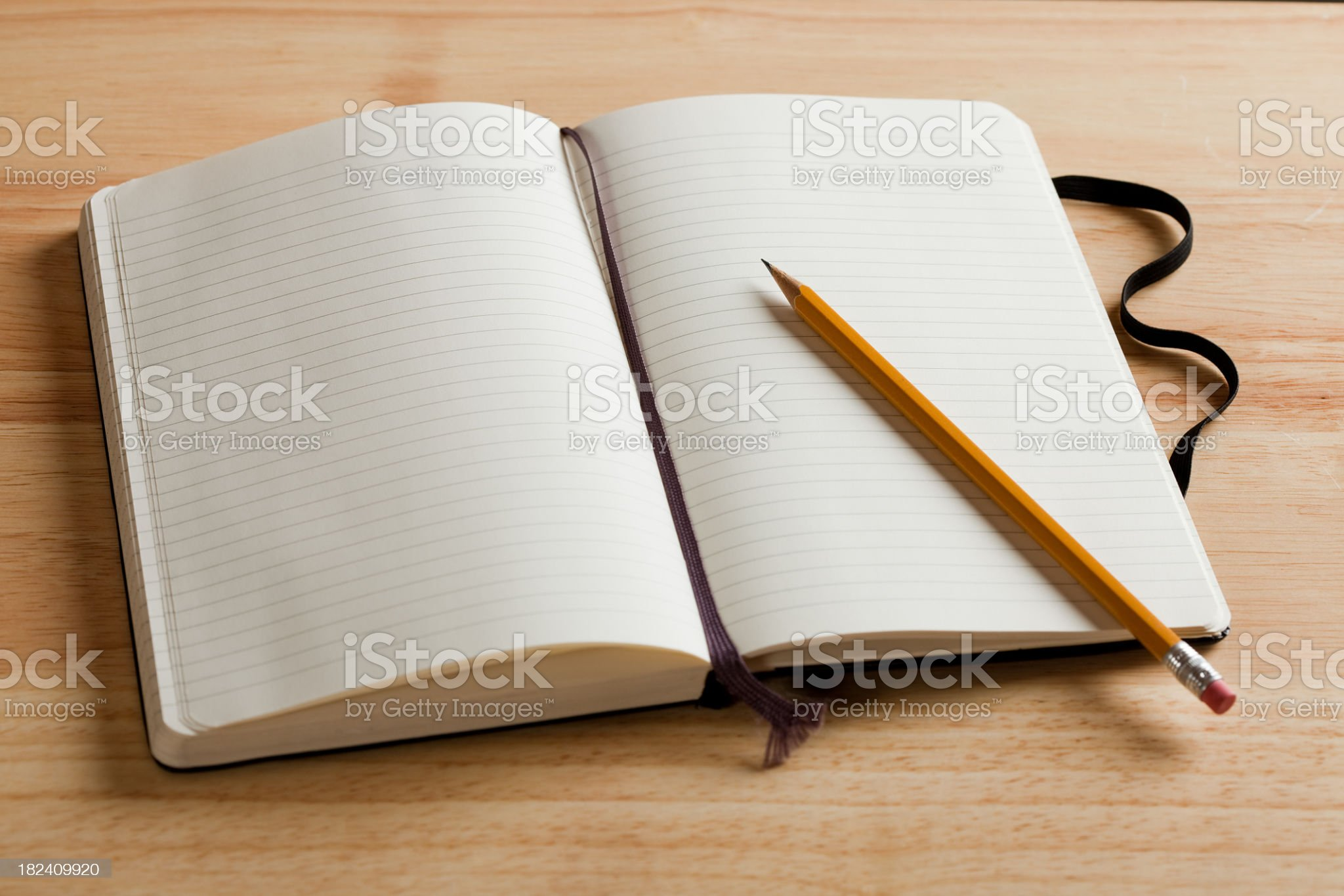 An empty journal open on a desk with a pencil royalty-free stock photo