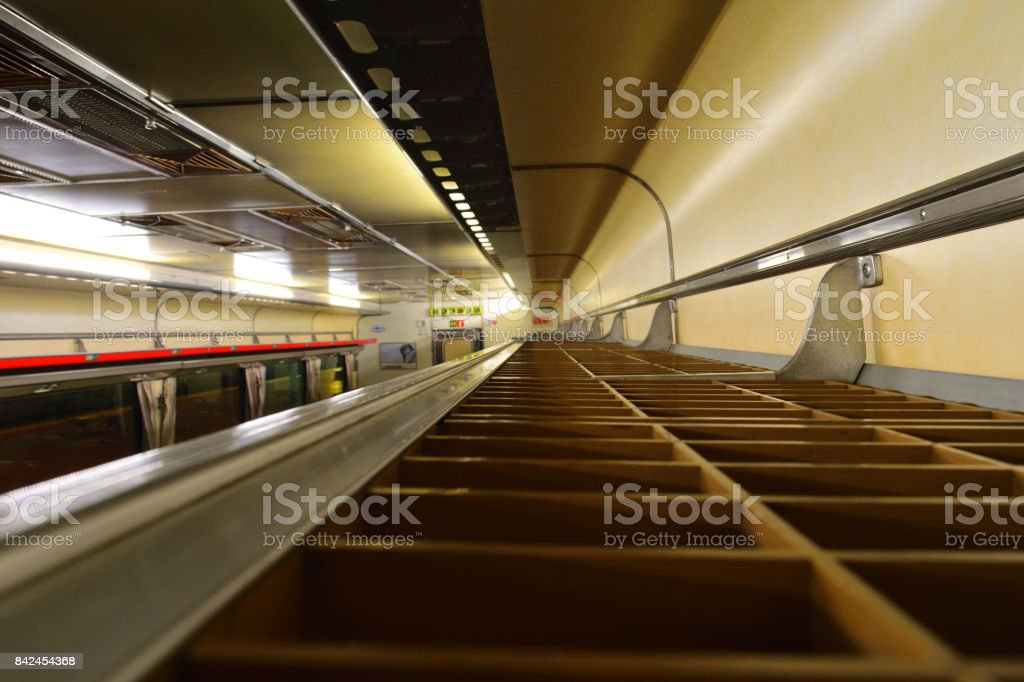 An empty luggage rack on a passenger train stock photo