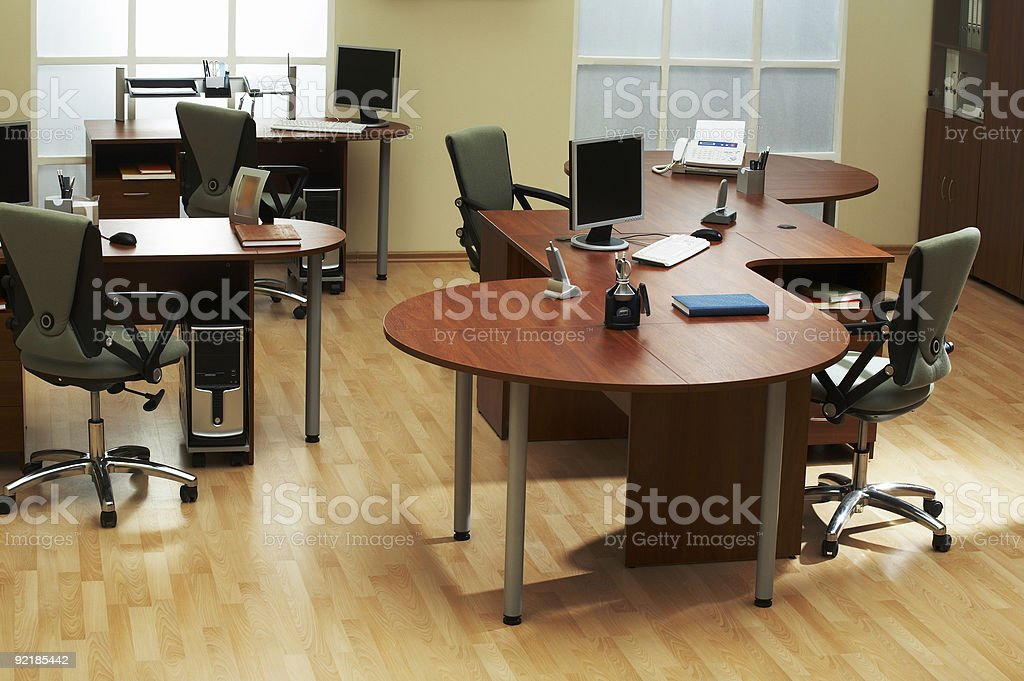An empty modern office with wooden desks and floor royalty-free stock photo
