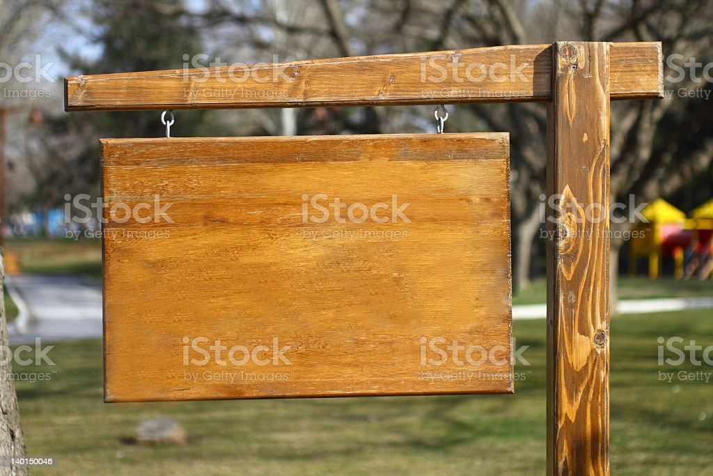 An empty old wooden sign hanging on the street royalty-free stock photo