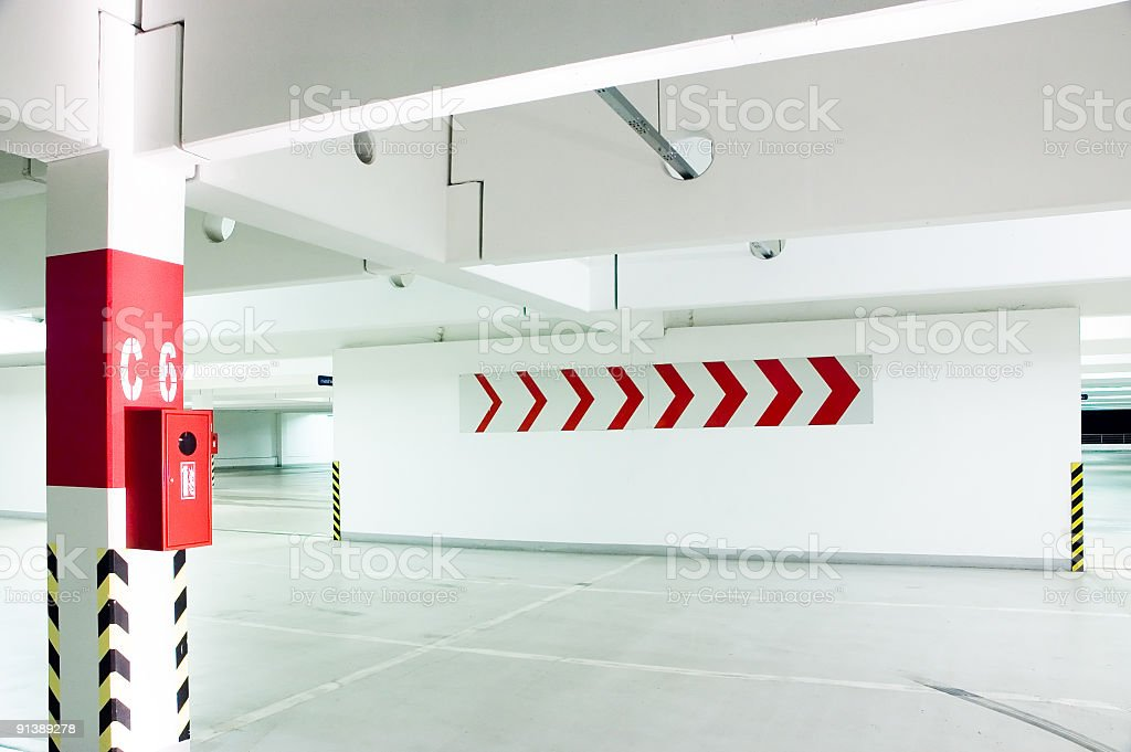 An empty parking lot with directional arrows royalty-free stock photo