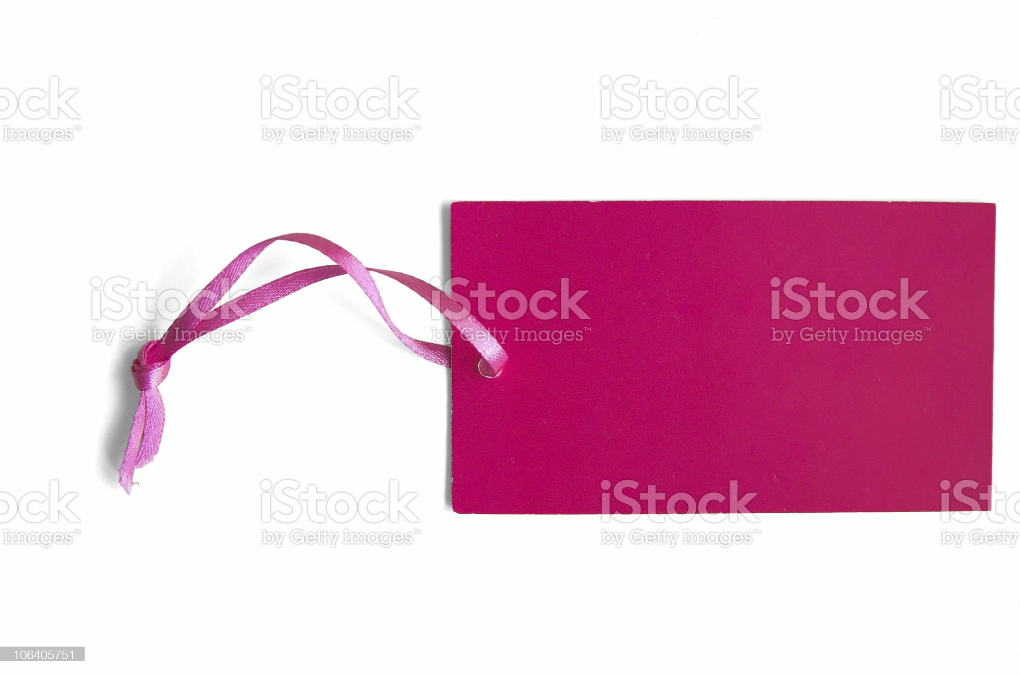 An empty pink tag with a pink ribbon isolated on white royalty-free stock photo