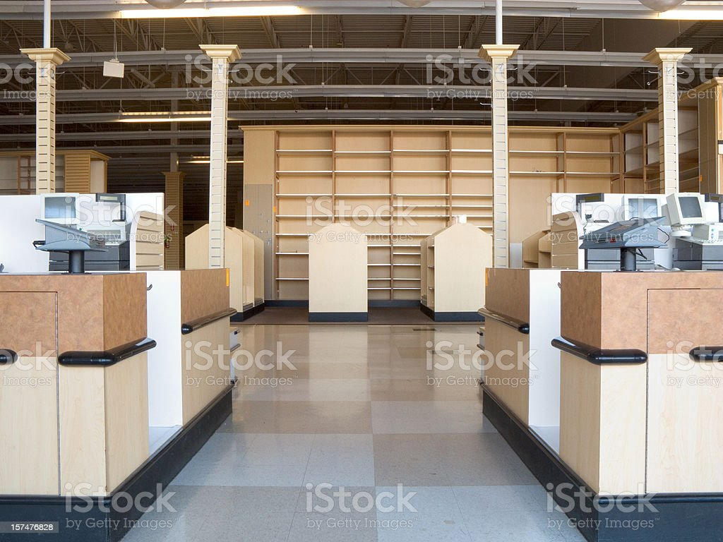 An empty retail store with checkered floors stock photo