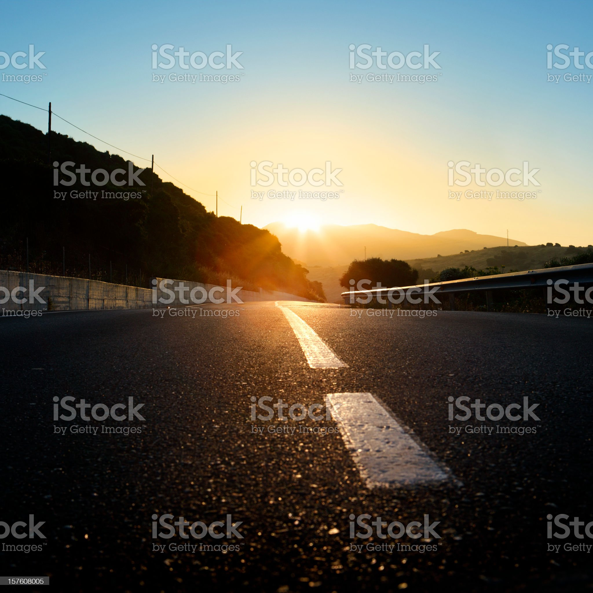 An empty road leading to a sunset royalty-free stock photo
