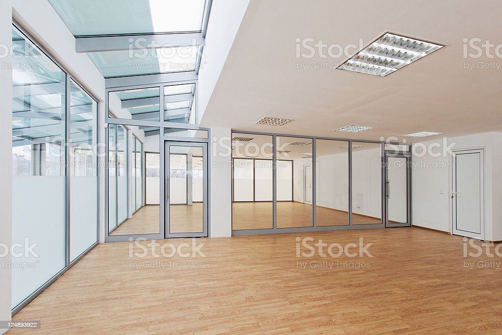 An empty room in an office bullpen area with natural light royalty-free stock photo