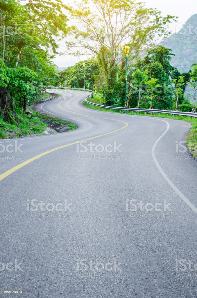 An empty S-Curved road stock photo