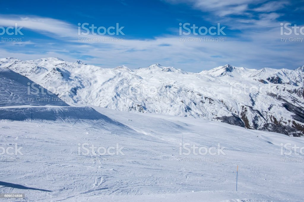 An empty ski piste in Meribel, Three Valleys ski resort in the French Alps, on a sunny, clear day in February 2017 stock photo