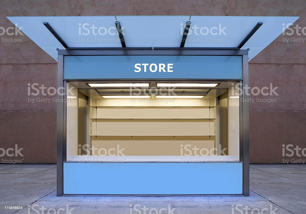 An empty store kiosk on the side of a road stock photo