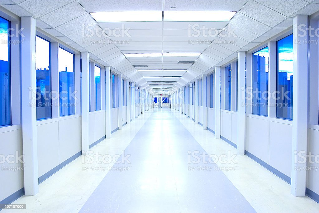 An empty white hall with blue windows royalty-free stock photo