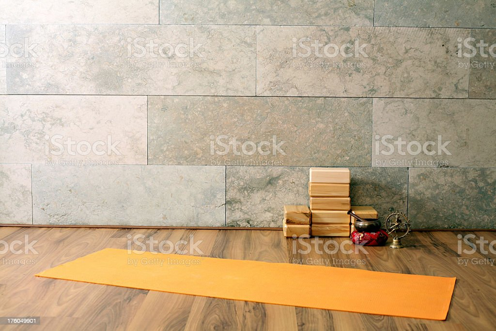 An empty yoga studio with a mat stock photo