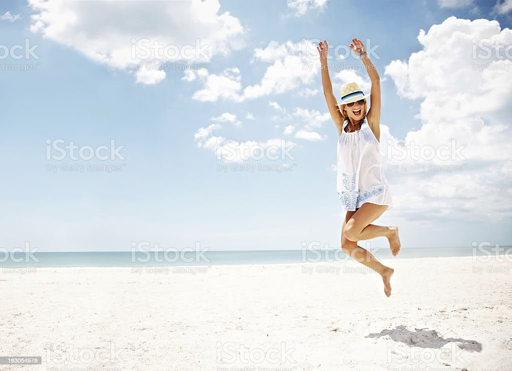 An energetic young female enjoying her vacation royalty-free stock photo